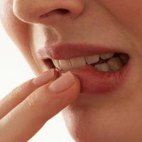 Воспаление десны около зуба